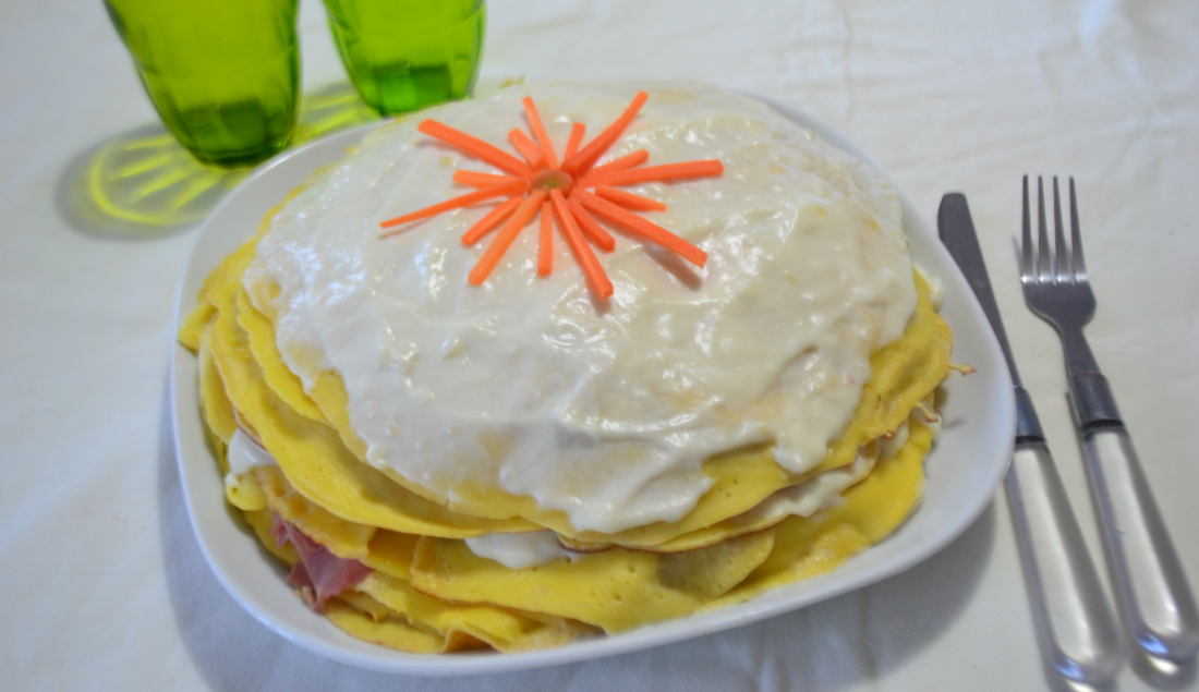 Torta crepes al prosciutto, formaggio e besciamella