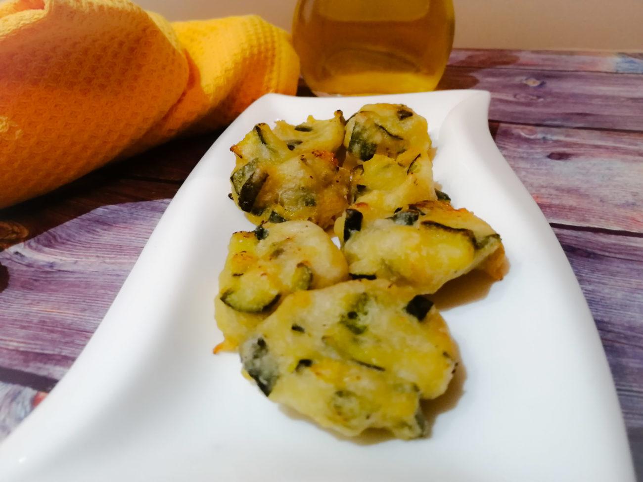 Frittelle di zucchine trifolate e Parmigiano